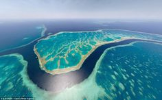 Looking down, down under! Australia's Great Barrier Reef looks a brilliant shade of turquoise in this lofty image from above