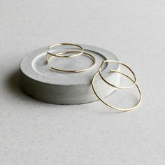 These handmade hoop earrings are crafted for each order. double hooped 3d form.