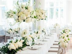 Chic and elegant affair in a prim palette of white and cream. Elevated arrangements full of peonies, hydrangea, lillies and roses grace the dining tables, while the bride and maids carry tidy bouquets accented with bits of greenery. Photos by Rebekah J. Murray Photography