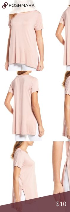"'Paola' Hi-Low Tee in Soft Pink Mix up your off-duty style with the drapey high/low silhouette of an ultrasoft stretch-jersey crewneck tee finished with generous side slits. Just spray with water to dewrinkle and you're good to go!  🍾🍾🍾🍾 🍥22"" length 🌸Crewneck 🍥Short sleeves 🌸Split high/low hem 🍥95% modal, 5% spandex 🌸Machine wash cold, dry flat 🍥Made in the USA 🌸Guided by ethical and sustainable practices, Amour Vert—""green love"" in French— made from natural fabric and dyes…"
