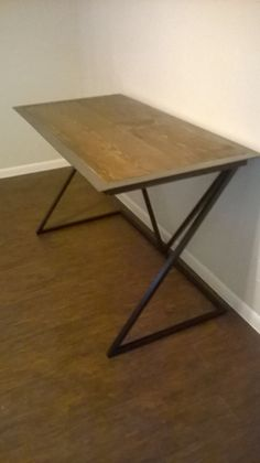 I created this desk in my home workshop using carbon steel and a pine top. Turned out awesome.