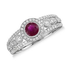 Fit for royalty, this split shank ruby and diamond halo ring features one deep red center ruby accented by 70 round diamonds and delicate milgrain details. A unique engagement ring choice.
