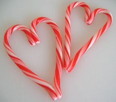 two candy canes into one big heart candy cane chain, curved end to straight end, tape. Hook next through the first, repeat.