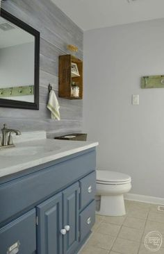 Bathroom makeover for under $200 including the whitewashed paneled wall.