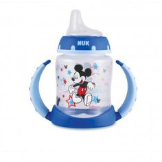 Make mealtime more fun with your favorite mouse. This learner cup from NUK® featuring Mickey Mouse helps make the transition from bottle to cup easier for your little one. The spill-proof, soft silicone spout is gentle on gums and the easy-grip, anti-slip handles are easy to hold, even for tiny hands. The cup features a colorful Mickey Mouse, stars, and silhouettes of his famous ears.