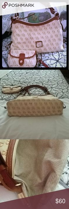 Dooney & Bourke Handbag/Wristlet Set Beautiful rich cream and saddle brown cotton canvas Dooney & Bourke Hobo bag with wristlet featuring the signature DB pattern. Excellent condition, only used a few times. Clean inside and out, with the exception of slightly dirty on the bottom and corners and a few small pen marks inside that are not noticeable. See pics and if you need additional pictures let me know. Dooney & Bourke Bags Hobos