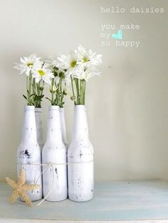 painted old coke bottles. Ocean theme Centerpieces. Embark