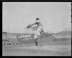 Cleveland Indian pitcher Bob Feller warming up before facing the Boston Red Sox at Fenway Park. 1940 - 1941 (approximate)