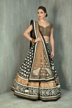 Cotton weaved ghagra embellished with thread and sequins work. Rawsilk blouse embellished with zari work and net dupatta.
