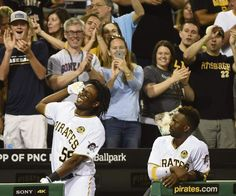 The Pirates' Josh Bell gets a curtain call from fans next to Andrew McCutchen after hitting a grand slam during the fifth inning against the Cubs Saturday, July 9, 2016, at PNC Park.