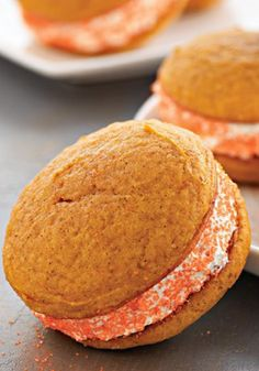 Pumpkin-Spiced Whoopie Pies with Ginger Cream -- When the dessert table is groaning from all those pumpkin pies piled on top, you'll be glad you brought Pumpkin-Spiced Whoopie Pies with Ginger Cream.