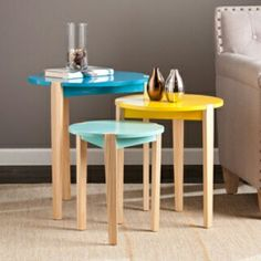 #CHCLLC Check out our Quinby Accent Table 3pc Set!  Overview: - Ascending sizes for staggered nesting  - Stackable when space is limited  - Playful look balances bold statement with contrasting, tapered legs  - Midcentury modern style with an eclectic touch  - Durable glossy finishes in blue, bold yellow, and minty blue with natural accents. Click here to order! http://www.captivatinghomecollection.com/product/quinby-accent-table-3pc-set/