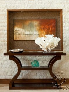 An interesting side table like this wouldn't be too imposing and chunky in the entry way. I like the idea of having a large piece of artwork behind it and some interesting pieces on it - travel finds?
