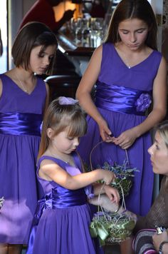 Flower girls with mini lavender bunches for the guests.