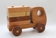 I love all the curves in Israeli designer Gad Agmon's wooden toys . Handmade from oak and mahogany, they are simple, ...