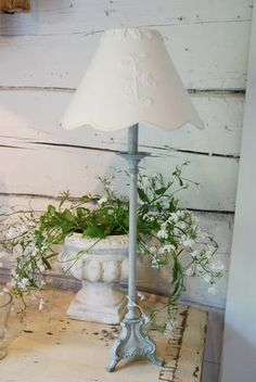 I love this table lamp with a lace lamp shade, urn, and rustic wood painted walls Beautiful Home Gardens, Beautiful Homes, Lace Lamp, Chandeliers, Cut Above The Rest, Romantic Homes, Shabby Chic Cottage, Shabby Vintage, Cottage Homes