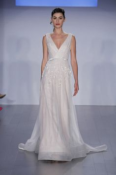 Jim Hjelm Bridal Fall 2015 Champagne A-line organza wedding dress with a V-neckline and beaded bodice