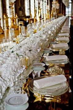 Opulent wedding with exquisite china, glassware, gold accents and all white flowers.