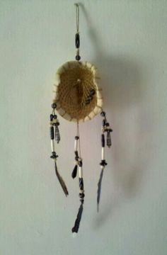 Dreamcatcher i made from a turtle shell found along the creek at my old house and feather from the yard of my new home