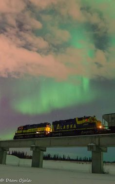 the Alaska Railroad under the northern lights by photographer Dean Ojala Sr. The train was backhauling empty coal cars Feb. 17 from Eielson Air Force Base through the Chena flood control area.