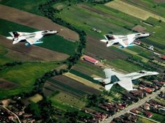 Royal Canadian Air Force Hornet training with Romanian Air Force Mikoyan at Câmpia Turzii, Romania, where the Canadian Air Task Force is participating in NATO reassurance measures. Military Helicopter, Military Aircraft, Mig 21, Hornet, Romania, Air Force, Fighter Jets, Aviation, Past