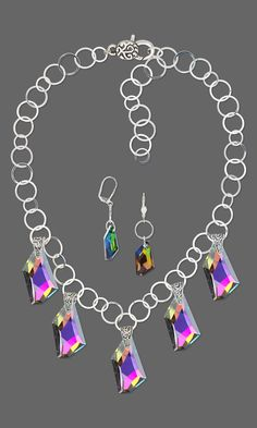 Jewelry Design - Single-Strand Necklace and Earring Set with Celestial Crystal® Drops and Focals and Sterling Silver Bails - Fire Mountain Gems and Beads