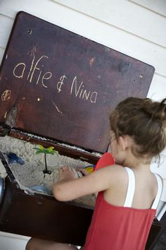 Alfie and Nina  sand in a suitcase, love this idea.