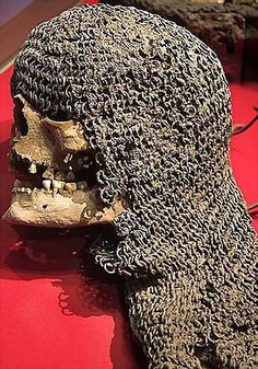 Europen riveted mail coif, from a mass grave, battle of Visby, fought in July 1361 on the Swedish Baltic island of Gotland, between invading Danish troops and the local Gutnish forces. The Danish won a decisive victory. Due to the heat, the dead had to be disposed of quickly, and many were buried in their armour. The archaeological excavation of one of the mass graves, in the 1930s, revealed over 1000 skeletons. Fornsalen Museum.