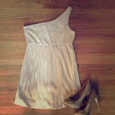 SALELight gold one shoulder cocktail dress  REDUCED Never worn. NWOT, New without tags!  One shoulder, champagne colored, bubble dress.  Varying colors of beautiful gold.  The perfect cocktail dress! Forever 21 Dresses