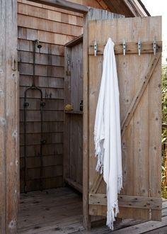 Shingled outdoor shower in a Fire Island A-frame | Remodelista