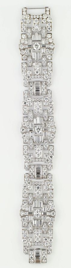 Impressive Art Deco 32 Ct Wide Diamond Platinum Bracelet. Impressive diamond & platinum wide bracelet, ca 1920s. It features exceptionally high quality round & baguette cut diamonds for its age, approx 32cts total weight.