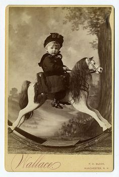 Child on vintage Rocking Horse