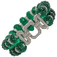 For Sale on - Fabulous Maharajah Jewel Collection carved faux emerald bead diamond bracelet made of two strands of hand carved faux emerald beads measuring each Candy Jewelry, Royal Jewelry, Art Deco Jewelry, High Jewelry, Jewelry Design, Unique Jewelry, Emerald Bracelet, Emerald Jewelry, Diamond Bracelets