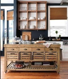 Wall color. White cabinets. Big dark wood island.