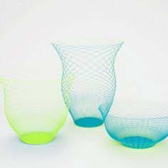"""Spooky but very creative.  """"Airvase"""" Yellow And Blue 3Pk, 22€.  Wafer thin woven paper that ship flat and pull up to mysteriously hold shape for imaginary flowers.  Torafu Architects, Japan."""