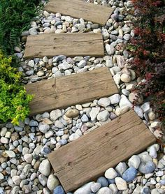 Railroad ties and stone pathway. More whimsy? Add color to the rrties and mix into the stones sea glass. Light the pathway? Paint larger stones with painted rocks that collect solar heat and light. Make it your own!