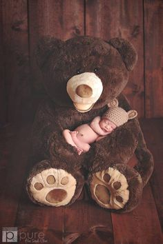 Love the big teddy holding the baby!