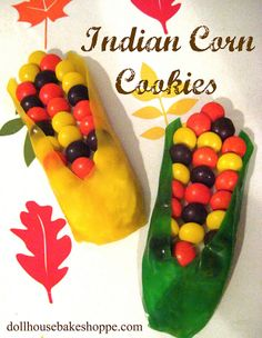 Indian Corn Cookies  You will need:  sugar cookie dough (homemade or store bought)  Spread (frosting, peanut butter, cream cheese, melted chocolate, etc.)  Reese's pieces  green fruit leather or fruit roll ups