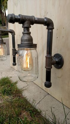 Add some quality indoor/outdoor time to your homes decor with these beautiful Edison Age vintage industrial fixtures that I make by hand with brand new parts: black steel pipe/couplings/fittings, retro quart-size Mason jars. Listing is for one fixture; usually sold in pairs (if youd like two fixtures, order quantity of two :)   FAQs  Ive been doing this for a while now and have shipped a lot of lamps (plus a lot of local pick-ups in Southern California) and I now know how the questions roll…