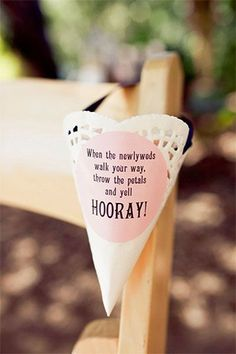 Will guests be tossing petals post-ceremony? Hang cones or little galvanized metal buckets filled with these pretty items on the backs of ceremony chairs — they'll double as pew décor.