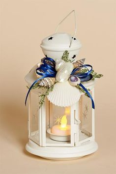 """8"""" White Metal Lantern with White Shell Removable Collar with Navy Blue Bow and Battery Tea Light"""