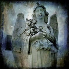 http://www.etsy.com/listing/56421888/blue-angel-vintage-dreamy-blue-gothic