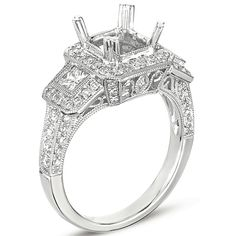 The filigree work on this antique three stone is amazing! Not to mention it has almost a carat of diamonds without a center stone! Engagement Ring by S.Kashi & Sons www.russellandballard.com