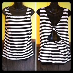 Michael KORS open back black and white tank Has adorable large peek a boo opening in the back. No flaws at all. Worn 1x. Not faded. Loose and stretchy. 94% rayon 6% spandex. MICHAEL Michael Kors Tops Tank Tops