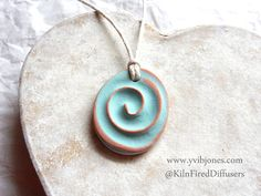Spiral of Life Aromatherapy Essential Oil Diffuser Yoga NECKLACE Turquoise Swirl Design Adjustable Terracotta Necklace by KilnFiredDiffusers on Etsy https://www.etsy.com/listing/241830114/spiral-of-life-aromatherapy-essential