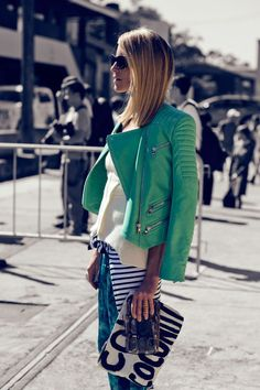 Printed pants and green leather coat