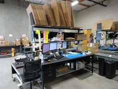 Lab Design and Renovation Packing Station, Efficient Packing, Warehouse Office, Lean Manufacturing, Vertical Storage, Brown Paper Packages, Home Office Organization, Working Area, Storage Rack