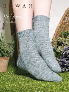 Verbena   Knit these toe up ladies socks, available as a free pattern. Designed by Sarah Hatton with a central lace motif they are worked in the Fine Art sock yarn.