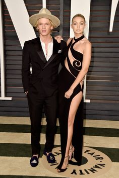 Model-of-the-moment Gigi Hadid arrived to the Vanity Fair Oscars after-party with her boyfriend, singer Cody Simpson. She also appeared in this month's Sports Illustrated swimsuit issue.