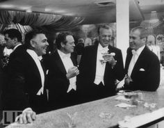 Happy New Year!!!    Clark Gable, Van Heflin, Gary Cooper, and Jimmy Stewart at a party in Beverly Hills on New Year's Eve, 1957.